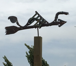 """Fred"" the weather vane braving the wind."